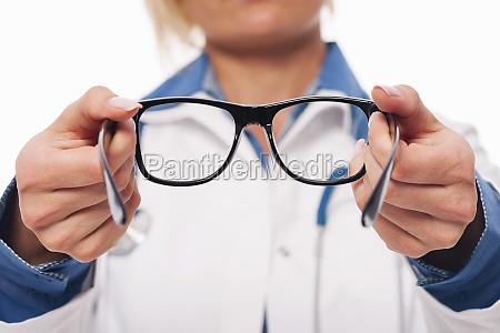 female optometrist giving new glasses