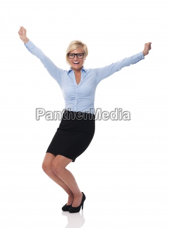 excited young businesswoman with hands raised