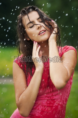 beautiful woman standing in the rain