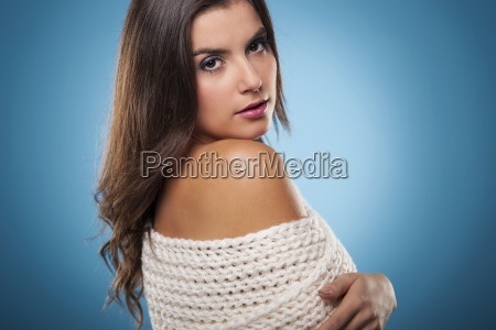 beauty woman wrapping on warm scarf