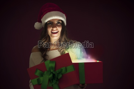 woman with santa hat opening magic