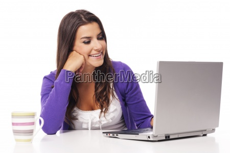 beautiful smiling woman using computer