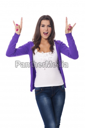 young woman showing hard rock hand