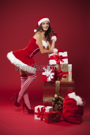 sexy mrs claus with christmas gifts