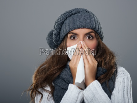 young, woman, wearing, warm, hat, sneezing - 12112748