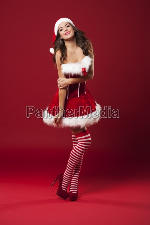 happy young woman posing in santa