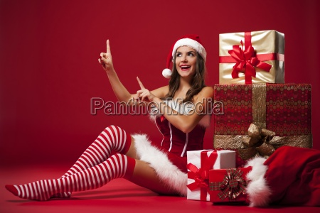 smiling and sexy santa claus woman