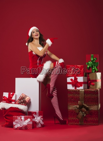 sexy santa woman showing at copy
