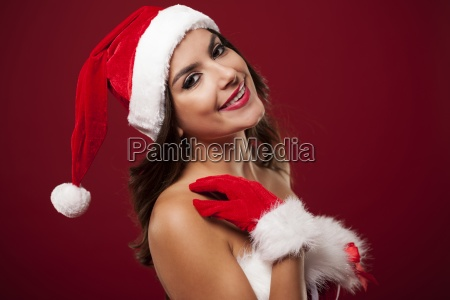 beauty and smiling woman wearing santa