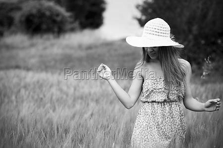 beauty woman walking through meadow black