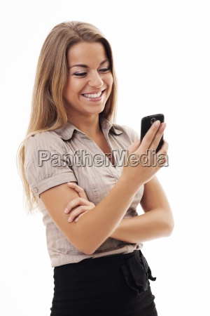 cheerful businesswoman texting on mobile phone