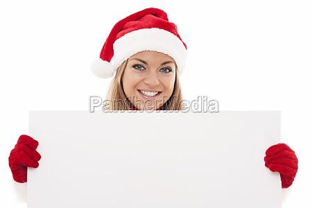 christmas woman holding blank board