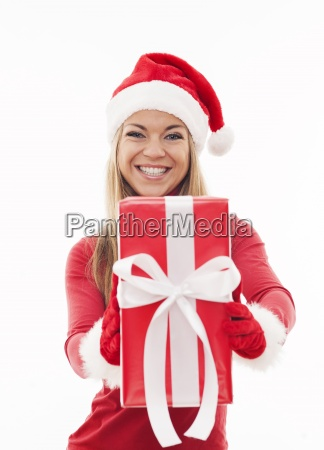 happy woman holding red present