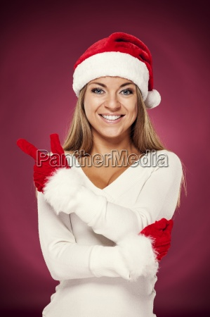 santa woman pointing at copyspace