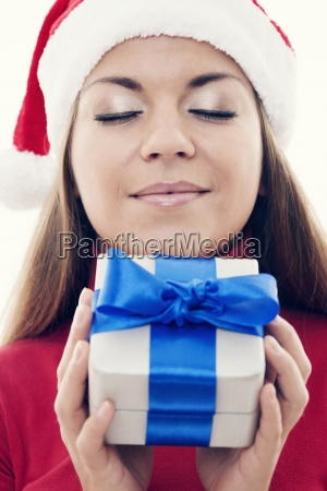 christmas time beautiful woman holding