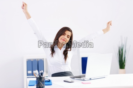 young woman streaching at office