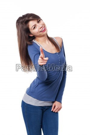 smiling woman pointing at camera