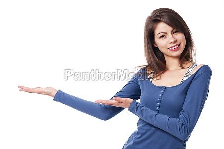 smiling woman presenting something
