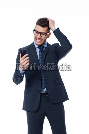 businessman reading a very bad news