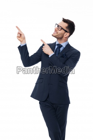 smiling young businessman pointing at copy