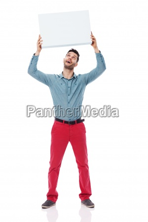 happy man holding a blank sign