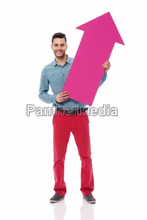 smiling man holding pink sign of