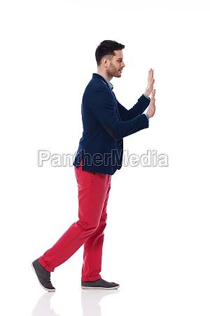 fashionable young man pushing something