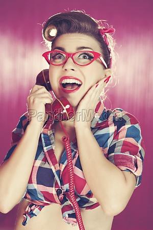 cheerful retro woman on the phone