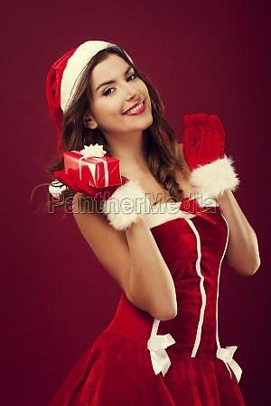 sexy santa woman holding christmas gift