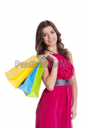 happy woman holding her shopping bags