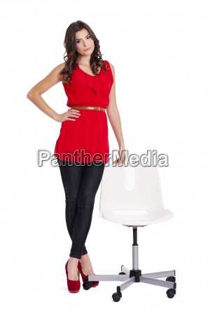 fashionable woman standing next to a