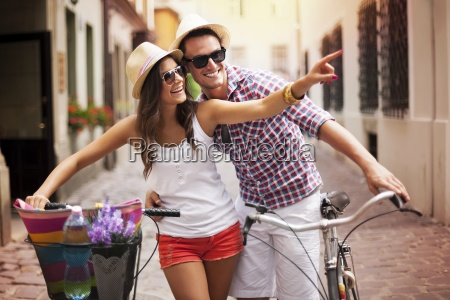 happy couple with bikes in the