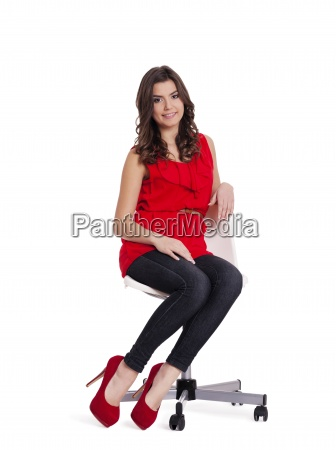 pretty, woman, sitting, on, a, chair - 12114532