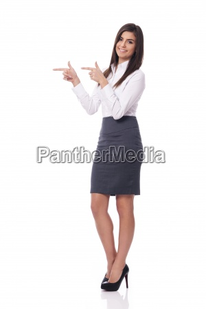 smiling businesswoman pointing to copy space