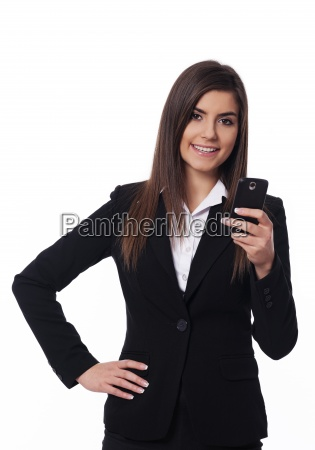 happy businesswoman using smart phone