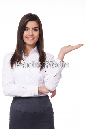 young businesswoman showing something