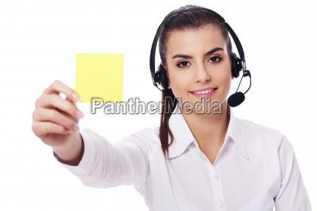 female operator holding yellow note