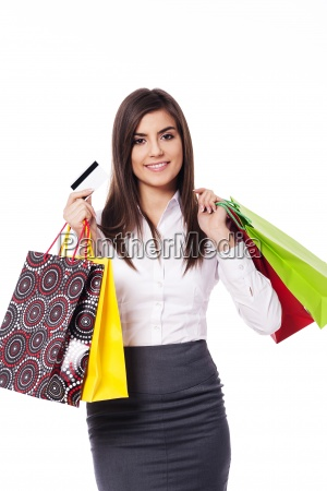 businesswoman with shopping bag and credit