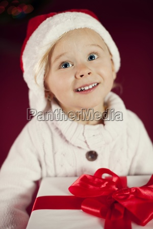 cute girl with santa hat holding