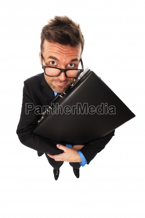 cunning businessman squeezing briefcase