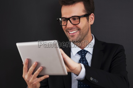businessman working on his touchpad