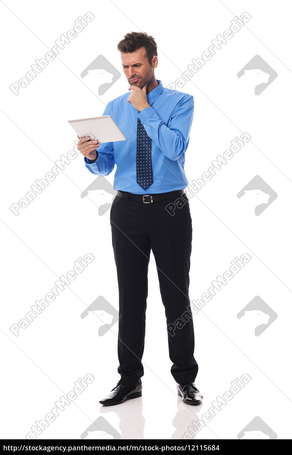 businessman, holding, digital, tablet, and, grimacing - 12115684