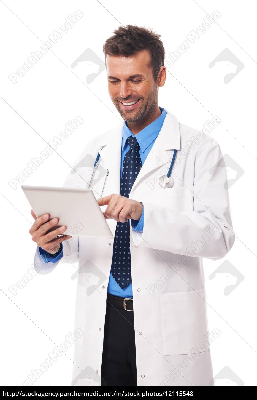 male, doctor, working, on, digital, tablet - 12115548
