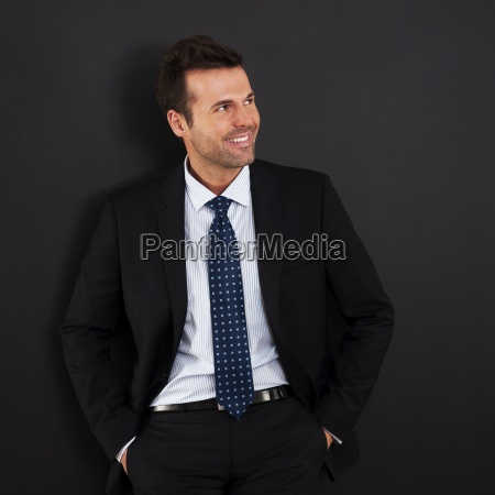 portrait of handsome and smiling businessman