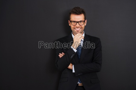 portrait of smiling businessman wearing glasses