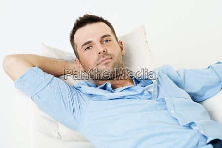handsome man relaxing with hand behind