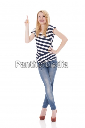 happy woman in striped blouse pointing