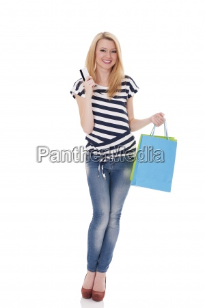 smiling shopper holding credit card and