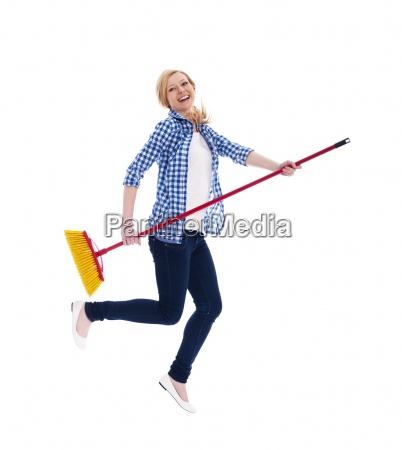 crazy female cleaner flying with broomstick
