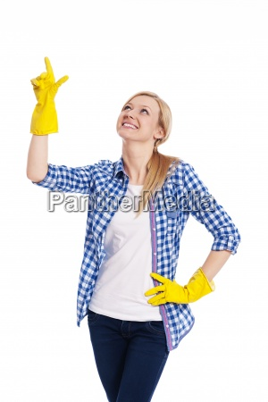 smiling female cleaner pointing up